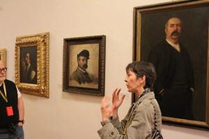 Carina legt uit dat hier de eerste tekenen van het impressionisme zichtbaar worden.